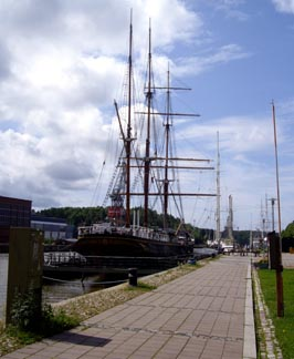 Image: ships at anchor in front of the Maritime Museum of Turku.